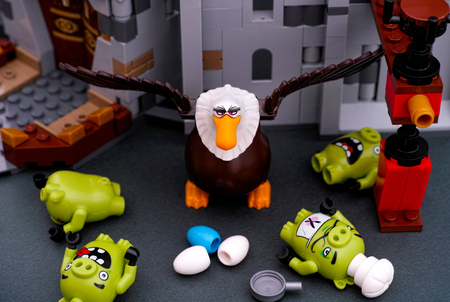 Tambov, Russian Federation - July 20, 2016 Lego Angry Birds. Four Bad Piggies defeated by Mighty Eagle near King Pigs Castle. Studio shot.