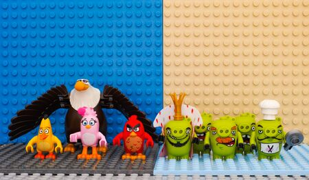 Tambov, Russian Federation - July 20, 2016 Lego Angry Birds - Red, Stella, Chuck, Mighty Eagle - versus Bad Piggies - King Pig, Chef Pig, Foreman Pig and Minion Pigs. Studio shot. Editorial