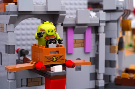 pig with wings: Tambov, Russian Federation - July 20, 2016 Lego Angry Birds. Foreman Pig sitting in TNT box with wings at King Pigs Castle. Studio shot. Editorial