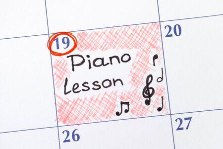 piano lesson: Reminder Piano Lesson in calendar. Close-up.