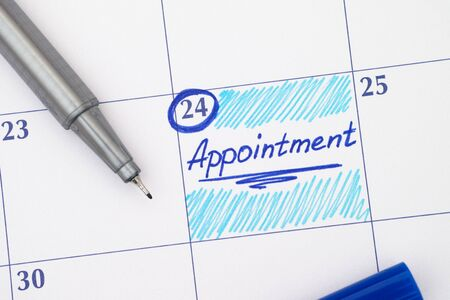 blue pen: Reminder Appointment in calendar with blue pen