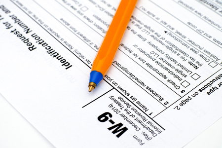 taxpayer: Application form W-9, Request for Taxpayer Identification Number (TIN) and Certification with ballpoint pen.