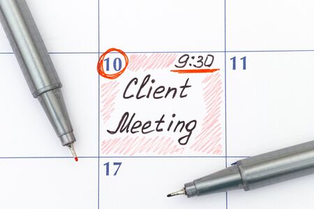 client meeting: Reminder Client Meeting 9-30 in calendar with two pens
