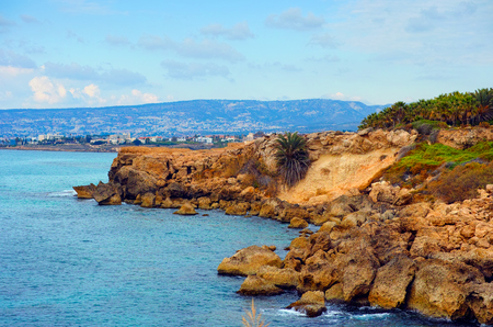 seacoast: Seacoast with rocks and mountains view. Mediterranean Sea, Cyprus, Paphos region. Stock Photo