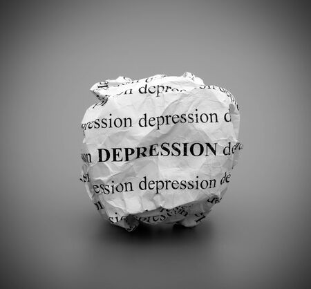 melancholia: Crumpled paper ball with words Depression on gray background. Black and white.