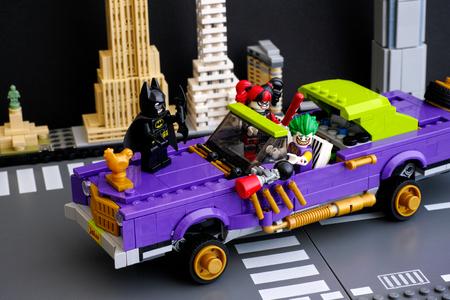 notorious: Tambov, Russian Federation - February 11, 2017 Lego Batman Movie. The Joker Notorious Lowrider in the city street with Batman, The Joker, Harley Quinn minifigures. Studio shot.