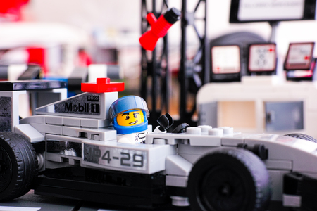 Tambov, Russian Federation - June 24, 2015: Lego driver sitting in McLaren Mercedes MP4-29 race car in McLaren Mercedes Pit Stop by Lego Speed Champions. Studio shot.