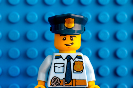 Tambov, Russian Federation - June 03, 2017 Portrait of Lego policeman minifigure with blue baseplate background. Studio shot. Sajtókép