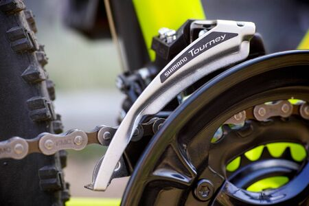 Tambov, Russian Federation - May 07, 2017 Close-up of Shimano Tourney front derailleur on bicycle chainwheel. Editorial