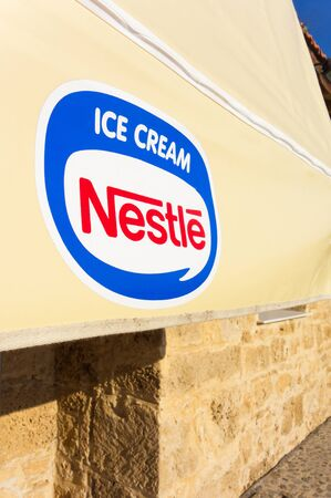 Paphos, Cyprus - November 13, 2013 Awning with Nestle Ice Cream logo in the street.