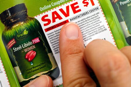 miserly: Tambov, Russian Federation - June 18, 2017 Person fingers on Irwin Naturals discount coupon.