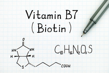 Chemical formula of Vitamin B7 (Biotin) with black pen.