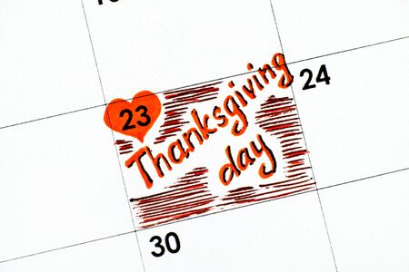 Reminder Thanksgiving day in calendar. Close-up.