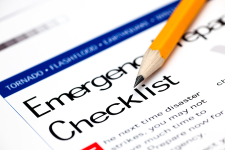 Emergency Preparedness Checklist with yellow pencil. Close-up.