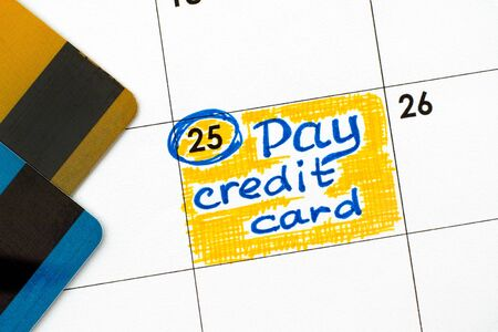 Reminder Pay Credit Card in calendar with credit cards. Close-up. Stock fotó