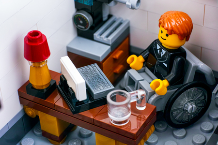 Stock Photo   Tambov, Russian Federation   October 18, 2017 Lego Office  Worker In Wheelchair On His Workplace. Studio Shot.