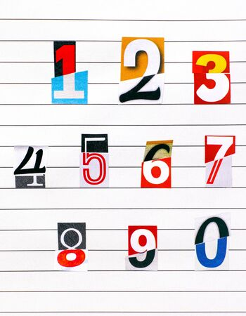 Ten numbers made from half numbers cutting from magazines on lined paper. Close-up. Stock Photo