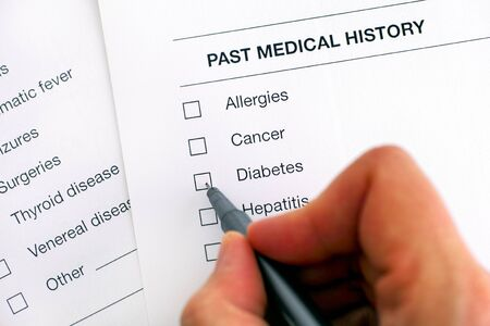 Past medical history questionary. Person hand with pen ready to ticked Diabetes. Close-up. Stockfoto
