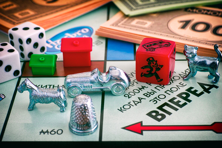 Tambov, Russian Federation - January 26, 2018 Monopoly Board Game. Field Go of gameboard with tokens, dices, money and houses. Studio shot.
