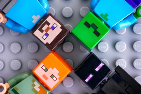 Tambov, Russian Federation - May 20, 2018 Four Lego Minecraft minifigures - Steve, Alex, enderman, zombie, on gray background. Studio shot. Editorial