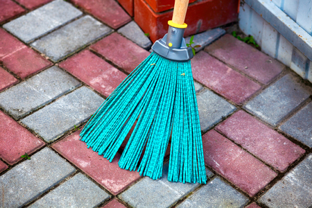 Close-up of plastic turquoise broom outside. Stock Photo