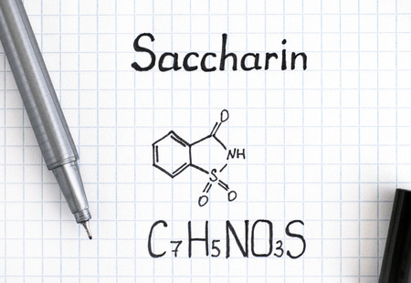 Chemical formula of Saccharin with pen. Close-up.