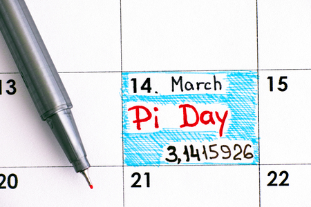Reminder Pi Day in calendar with red pen. Pi Day is celebrated on March 14th (3/14) around the world. Stock Photo