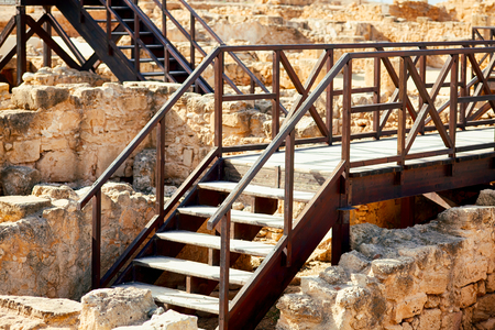 Wooden stairs with bridges over the ruins of ancient buildings. Reklamní fotografie