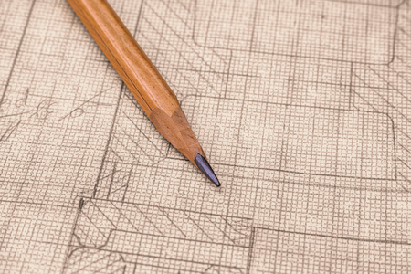 Old technical drawing on graph paper with pencil. Close up. Stock Photo