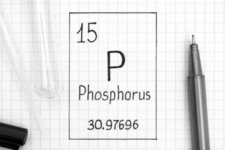 The Periodic table of elements. Handwriting chemical element Phosphorus P with black pen, test tube and pipette. Close-up.