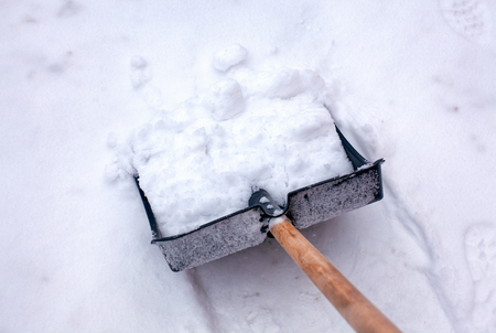 Shovel for snow cleaning in snow. Close-up.