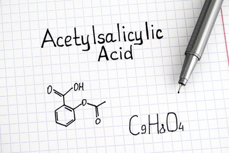 Chemical formula of Acetylsalicylic Acid with pen. Closeup.