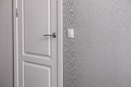 Closed white interroom door with handle.