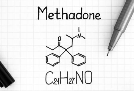 Chemical formula of Methadone with black pen. Close up.