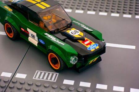 Tambov, Russian Federation - July 02, 2019 Lego 1968 Ford Mustang Fastback car by LEGO Speed Champions on road baseplates. Studio shot.