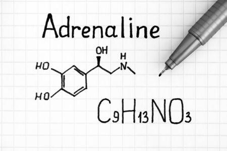 Handwriting Chemical formula of Adrenaline with pen. Close up. 版權商用圖片