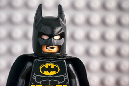 Tambov, Russian Federation - July 29, 2018 Portrait of Lego Batman minifigure against LEGO gray baseplate background.