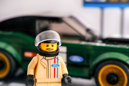 Tambov, Russian Federation - July 02, 2019 Lego 1968 Ford Mustang Fastback driver minifigure by LEGO Speed Champions against his car. Editorial