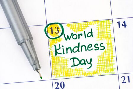 Reminder World Kindness Day in calendar with green pen. November 13. Imagens