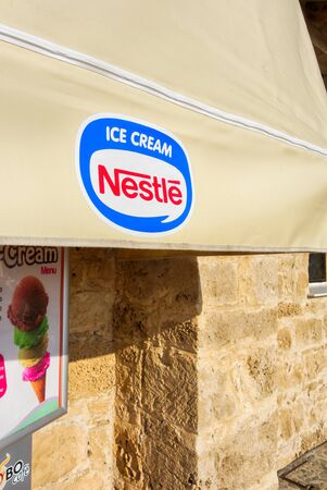 Paphos, Cyprus - November 13, 2013 Awning of street cafe with Nestle Ice Cream logo. Editorial