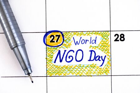 Reminder World NGO Day in calendar with pen. February 27. 免版税图像