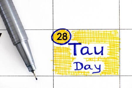 Reminder Tau Day in calendar with pen. June 28.