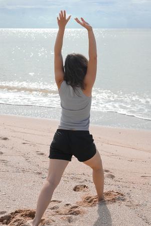 Woman doing yoga on beach Stock Photo - 13577693