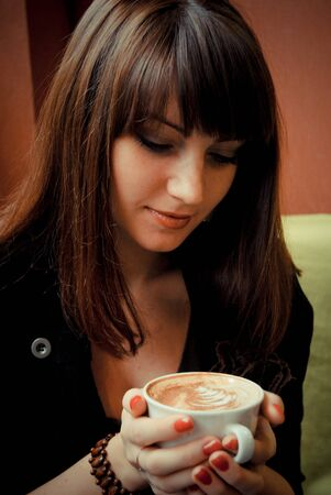 capuccino: Woman having cup of capuccino Stock Photo