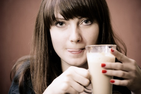 capuccino: Young woman with glass of capuccino