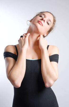 Young woman with pain in neck photo