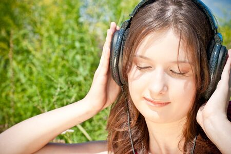 Teen girl with headphones photo