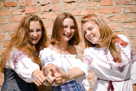 Three happy teen friends showing thumbs up Stock Photo - 17198450
