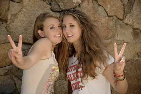 Two teen girls showing peace sign Stock Photo - 17198449