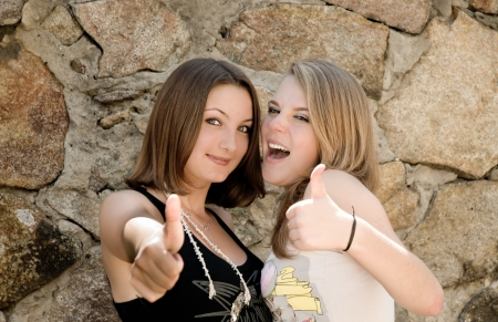 Two teen girls showing okay sign Stock Photo - 17198177
